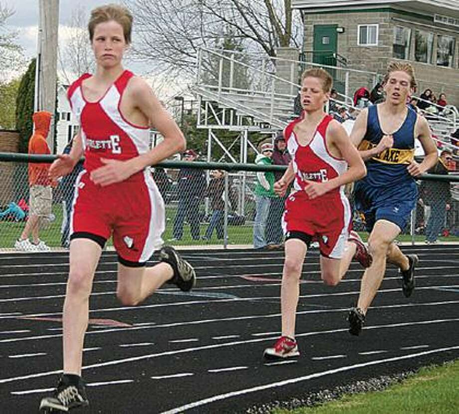 Marlette's Jacob Bowman and Andy Bowman round the curve as they competed in the 1600 meter run during the Brown City Invitational. Jacob Bowman posted a fourth at 5:03.44 while Andy Bowman was fifth at 5:09.03.