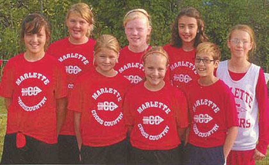 Pictured from left to right front row are Cheyene Hinojosa, Alissa Bradeen, Haley Byers and Madolyn Clark. Back row left to right Belle Chappel, Lexi Wilhelmsen, Renee Miller and Emily Koons as the team started the 2010 campaign with a strong performance at the Algonac Cross Country Invitational.
