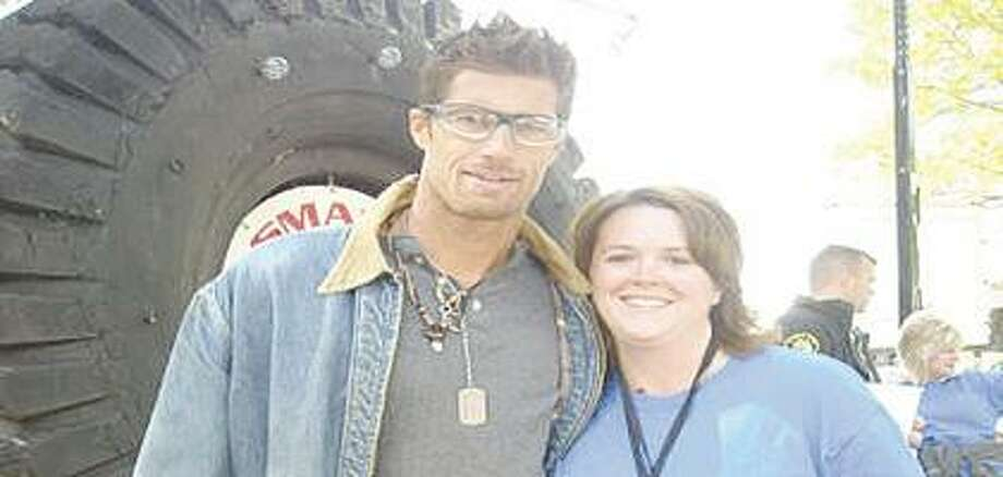 Tricia (Lerash) VanderPloeg, a native of Bad Axe, poses with Rib Hillis, a designer the television show Extreme Makeover: Home Edition. VanderPloeg took part behind the scenes in a home makeover for the Nickless family.