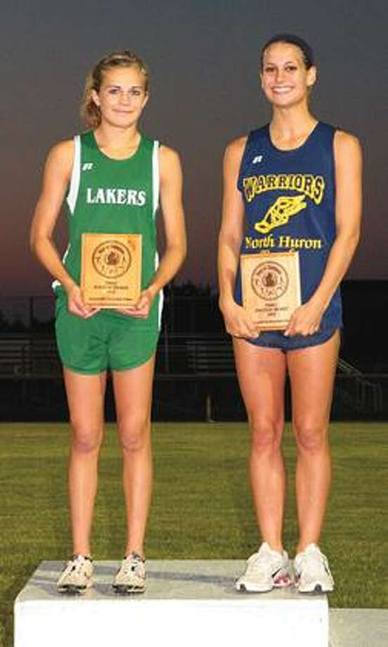 EPBP's Gala Shivley and North Huron's Megan Heffner proudly display their plaques after sharing Female Athlete of the Meet honors.