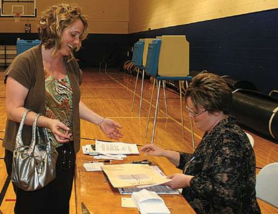 Amy Smithers hands in her ballot.