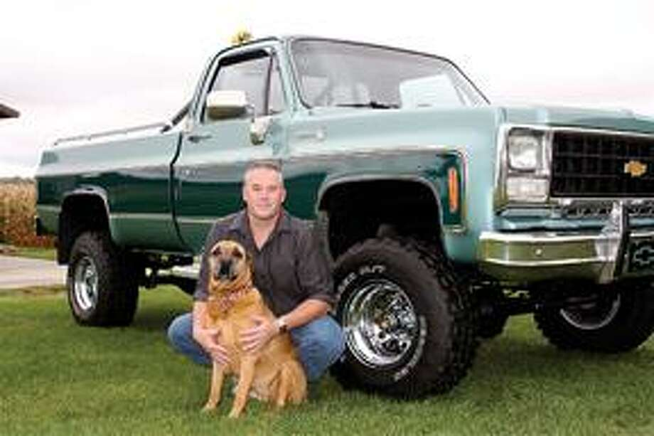 Colfax Township resident Rob Sowles poses with his dog, Sami, and his 1980 Chevy pick up truck.