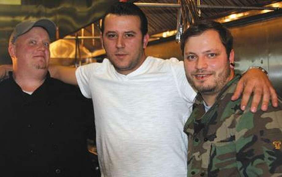 John Camaj, center, Tom Klosowski, Mirsad Cunmulaj.