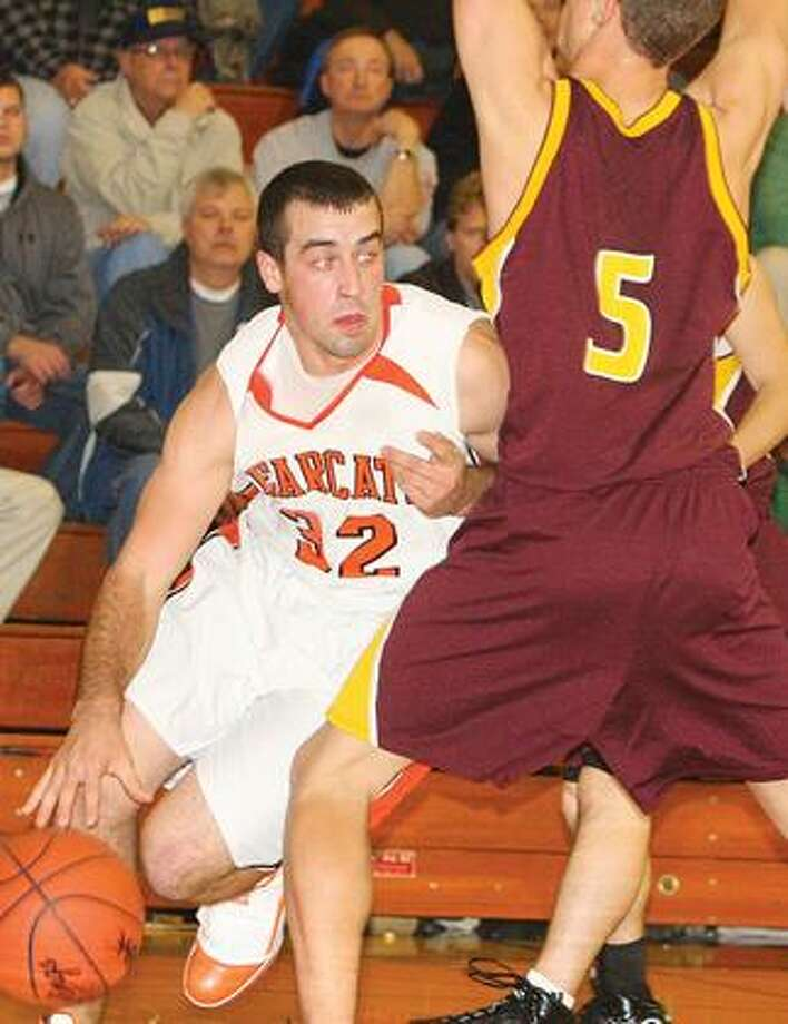 Ubly's Eric Booms (32) drives around Reese's Jared Bender (5) in the first half.