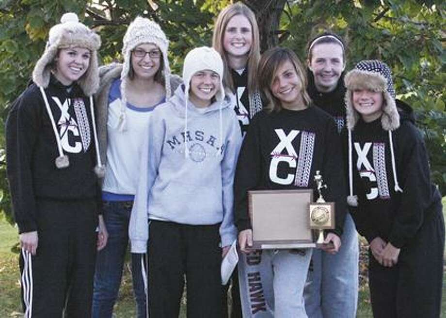The Cass City girls are all smiles after winning the Greater Thumb West cross country championship on Tuesday.