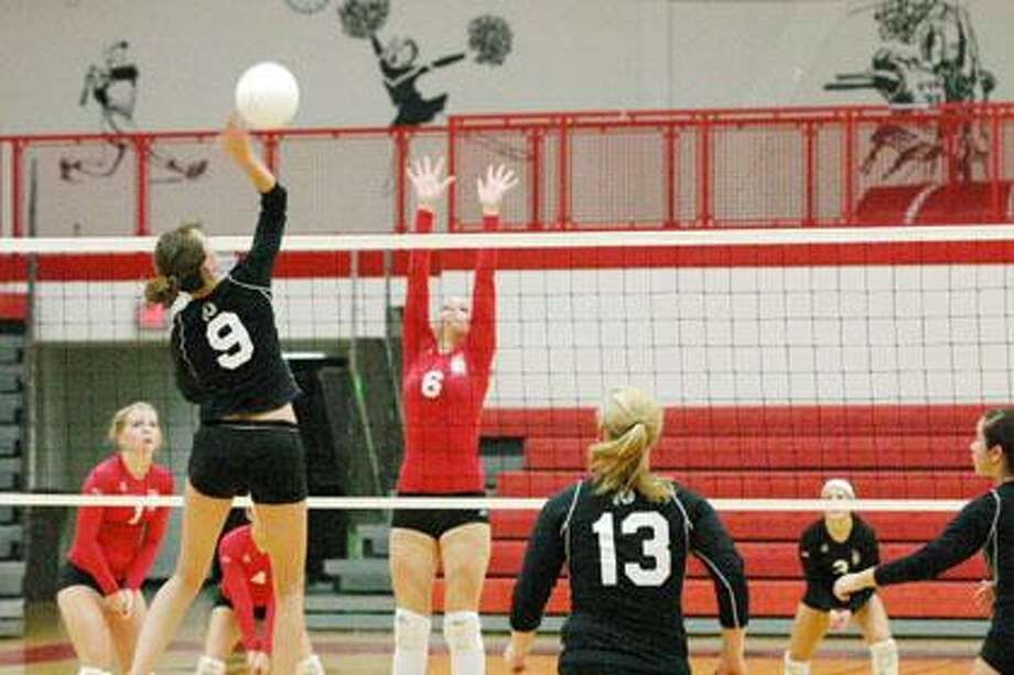 Marlette's Tanya Braswell goes up for the kill as the Marlette varsity volleyball team traveled to Sandusky and stopped the Redskins. Looking on are teammates Kelsey Roggenbuck, Keara Wilson and Keagan Wilson.