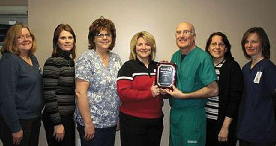 Pictured left to right is Chloe Ann Valentine, Anita Schierlinger, MSN FNP-BC, Deb Friedli, Jamie Betz, from Health Plus of Michigan, Dr. Starbird, Sandy Starbird, and Heather Boyne.
