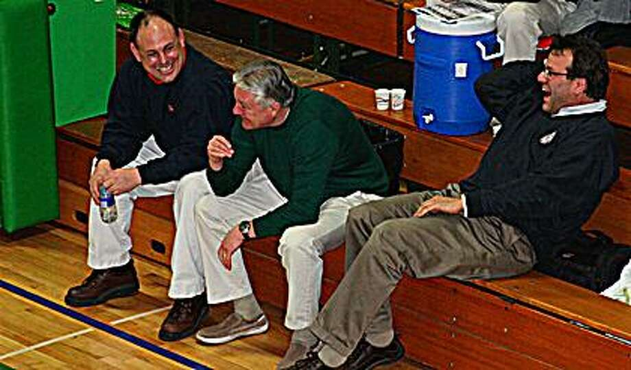 "(From left) USA assistant basketball coach Steve Bohn, EPBP head coach Bill McLellan, and USA head coach Mark Gainforth share a funny moment before a game last week. After 32 seasons and 474 career wins, McLellan is retiring from his post at Lakers. Says Gainforth: ""Bill is a (coaching) pioneer."""