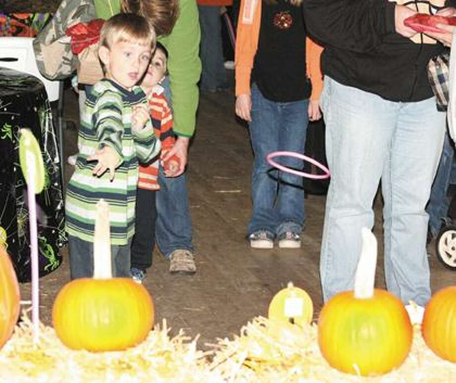 Renton Wright takes part in the Pumpkin Ring Toss.