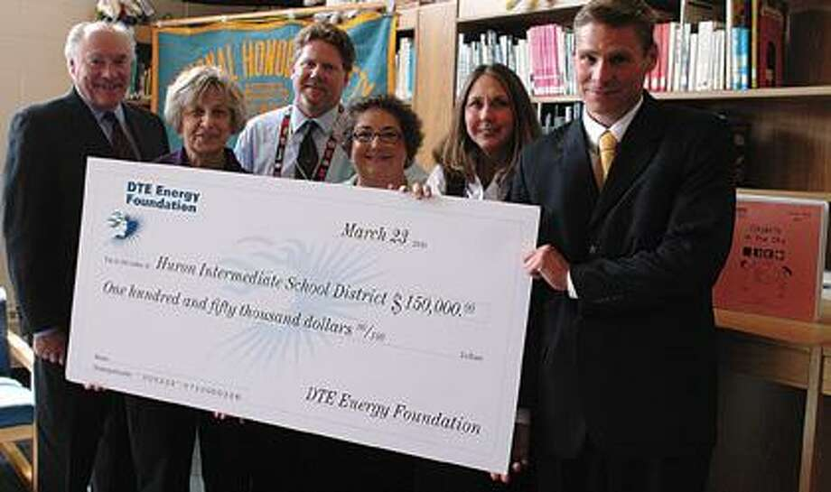 DTE Energy presents HISD with a $150,000 check.