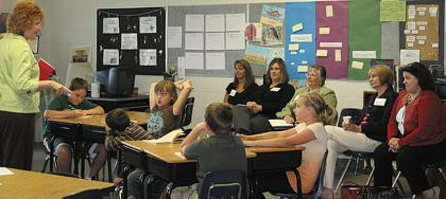 CLS teacher Gwynne Barry directs a lesson.