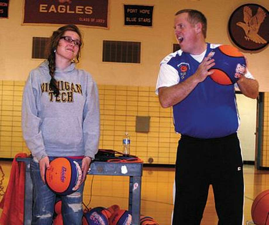 "CHS student Veronica Sauer and Jim ""Basketball"" Jones."