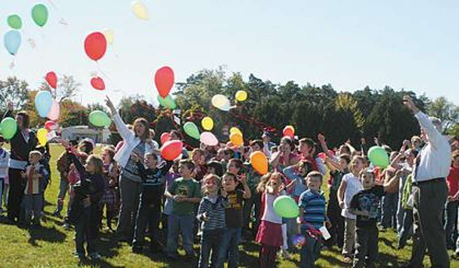 Owen-Gage youngsters excitedly release balloons