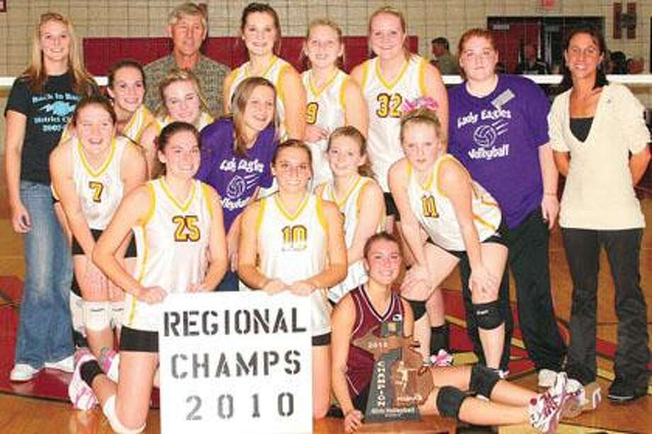 Deckerville players, coaches and managers are all smiles after winning the Class D regional volleyball championship on Thursday in Peck by beating Bay City All Saints.