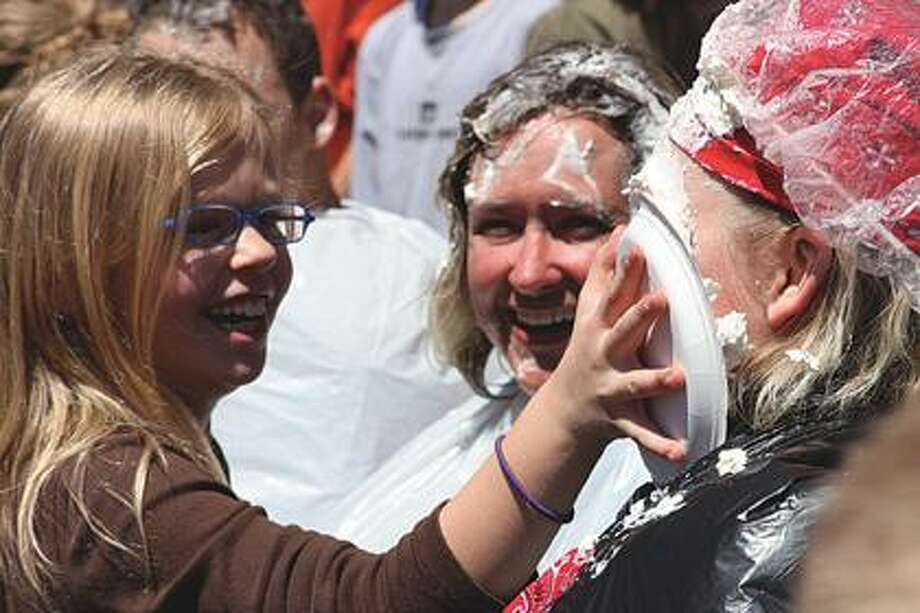 Kaylin Ewald smooshes a pie in Shannon Bowman's face.