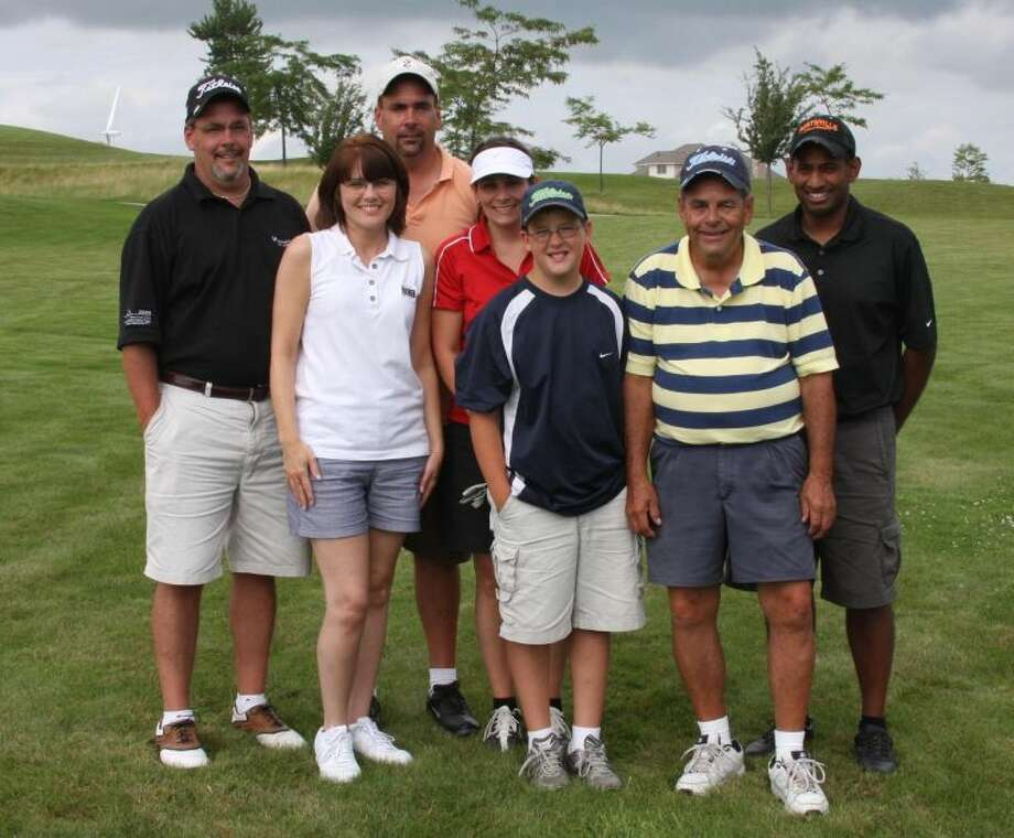 Some of the Grigg family who took part in Saturday's event include (from left) Rod Grigg, Donna Grigg (Troy's wife), Troy Grigg, Shari (Grigg) Thakady, Kyle Grigg (Rod's son), Bob Grigg and Anil Thakady.