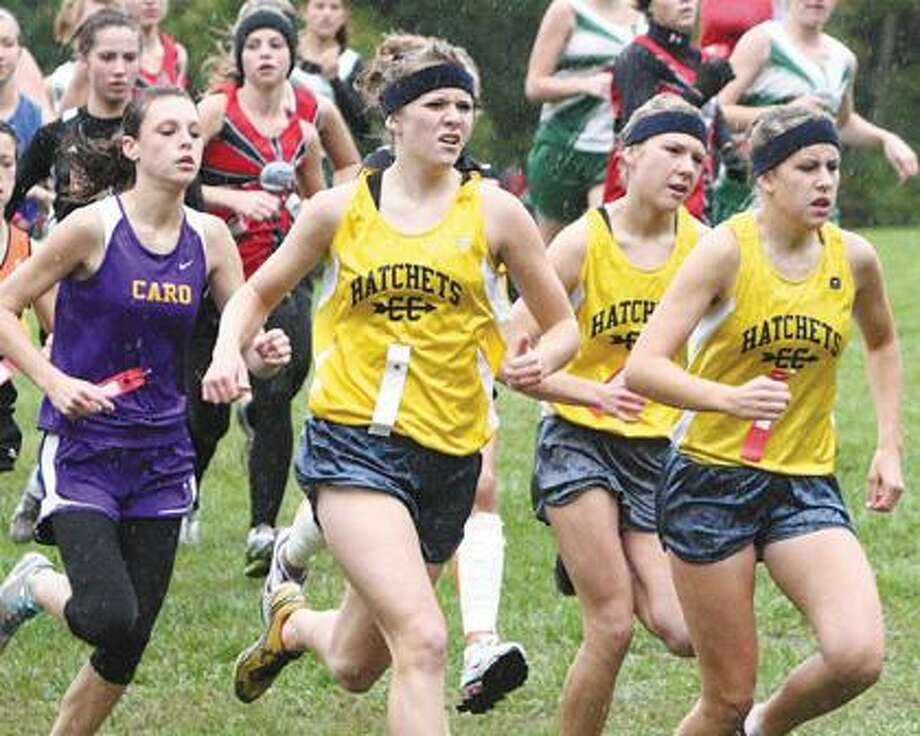 Bad Axe runners (from left) Crystal Schaible, Hailey Richards and Cassie Hanson are grouped together on Saturday near the start of the Wagener Park Invitational.