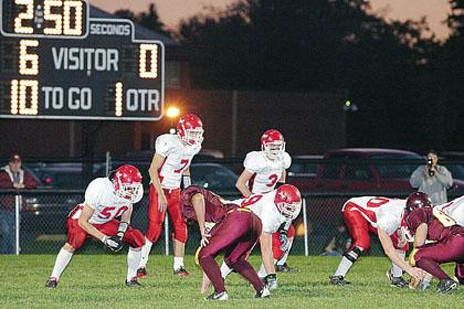 Marlette quarterback Kolby Lange awaits the snap during first quarter action October 8th at Deckerville. Following an early Eagle score, Lange scored three touchdowns for Marlette, including the game winner with 35 seconds remaining in a 21-20 Marlette win.