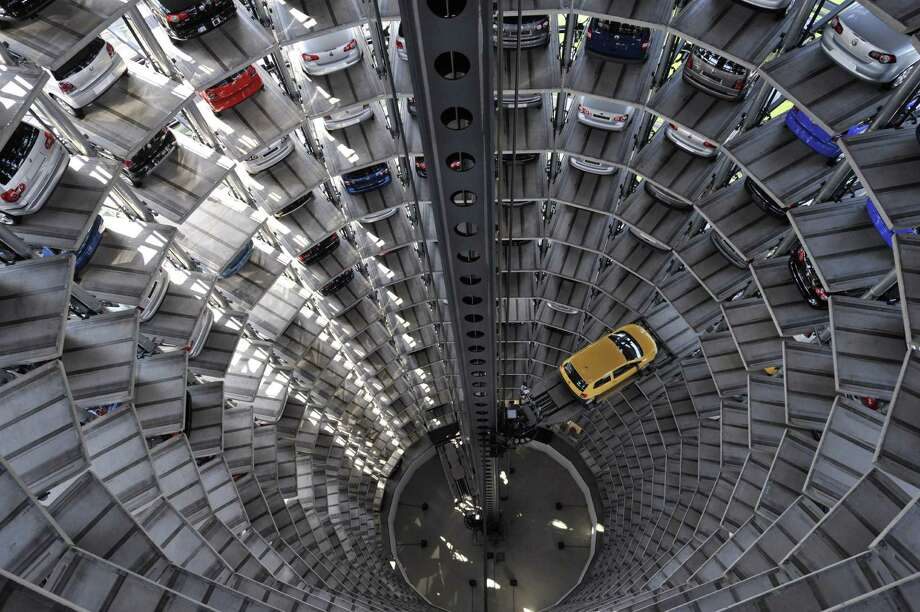 Embattled German carmaker Volkswagen said Friday it is setting aside $18.2 billion in provisions to cover the anticipated costs of the global engine-rigging scandal it is engulfed in. The massive charge pushed the auto giant deeply into the red in its 2015 accounts. Photo: AFP /Getty Images File Photo / AFP or licensors