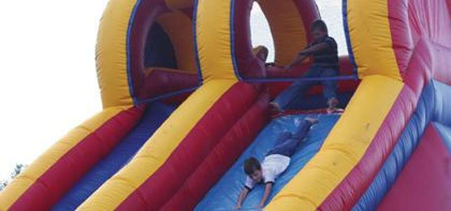 Children played on the inflatables during the barbecue.