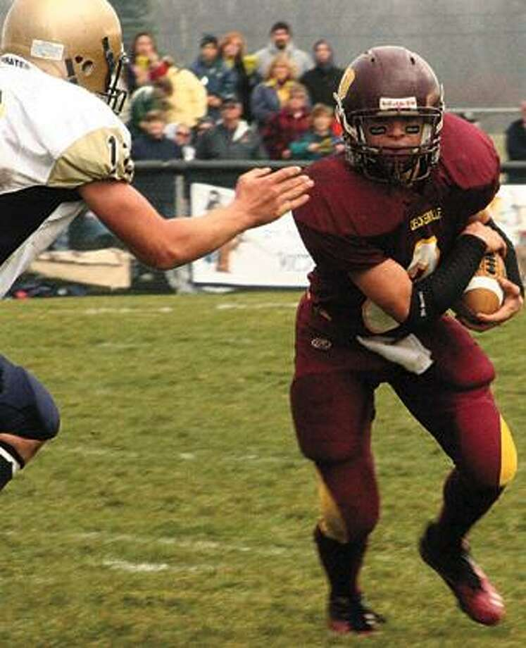 Deckerville quarterback Tyler Pattullo tries to avoid a Fulton defender while rounding the end.