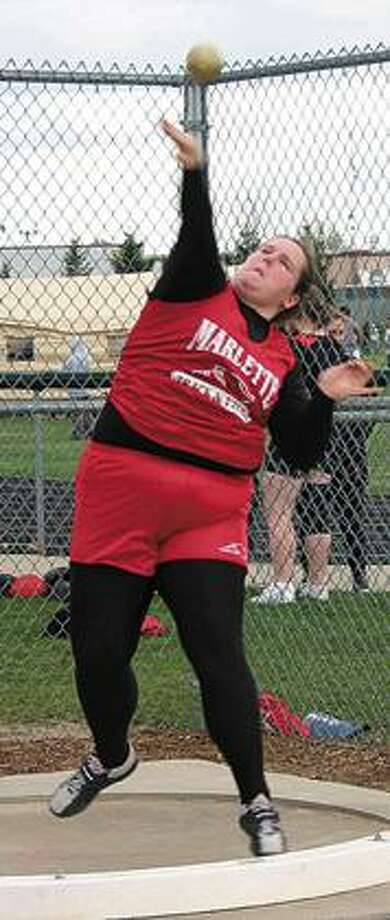 Marlette's Tiffany Gomes shows her form as she competes in the shot put during the Brown City Invitational.