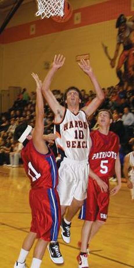 Harbor Beach's Sean Sorenson goes in for a layup.