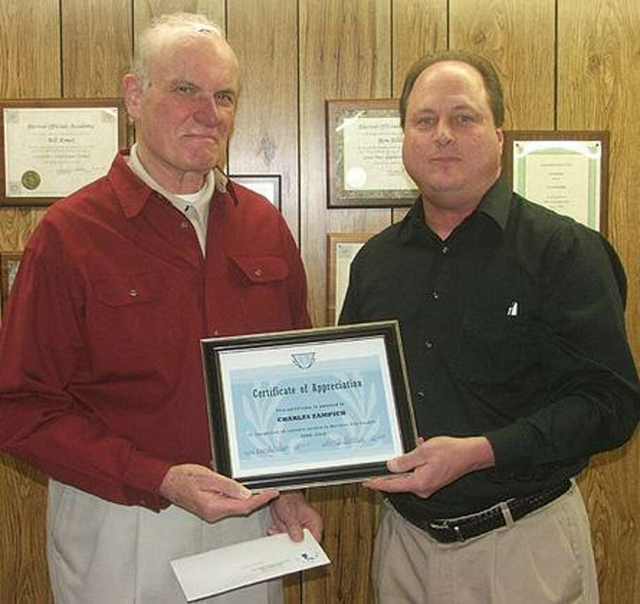 Marlette Mayor Donald Redman, right, presented Chuck Zampich with a Certificate of Appreciation from the City of Marlette for his years of service on the Marlette City Council at council's December 6th meeting. Zampich also served as village and alter city manager of marlette for over 20 years.