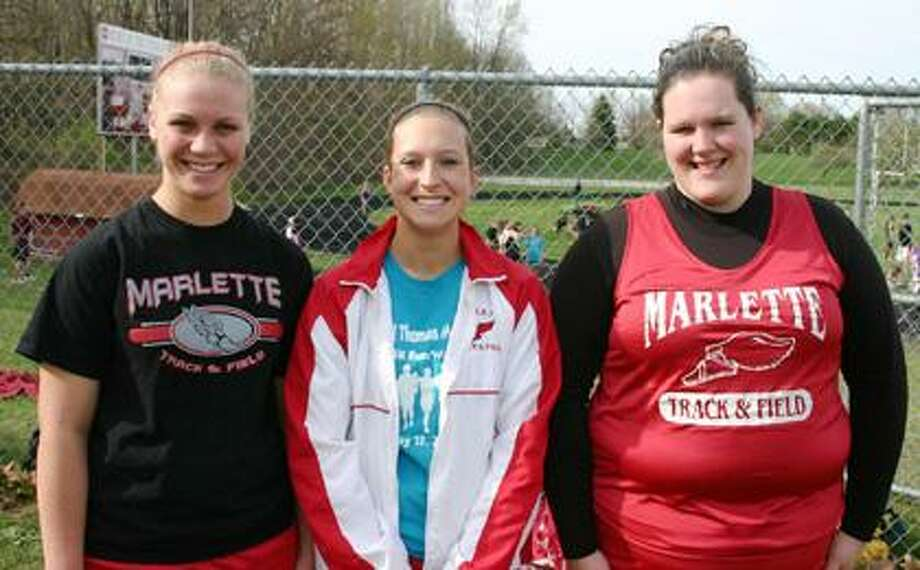 "The Marlette girls shot put relay team captured first place at the Wildcat Relays with a combined toss of 87'10.50"". Pictured are Kylee Dobbelaere, Amara Wilson and Tiffany Gomes."