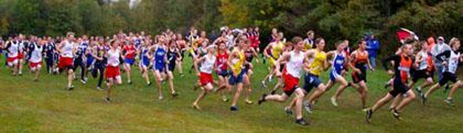 he Marlette boys cross country team begins their race with 18 teams and over 120 runners on a cold wet morning Oct. 2 at Wagener State Park in Harbor Beach.