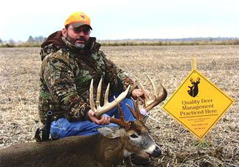 McCrea poses with his 18-point buck.