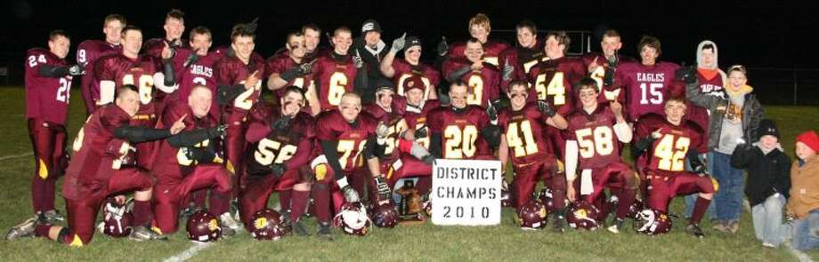 Deckerville is all smiles after capturing the Division 8 district championship trophy Friday night.