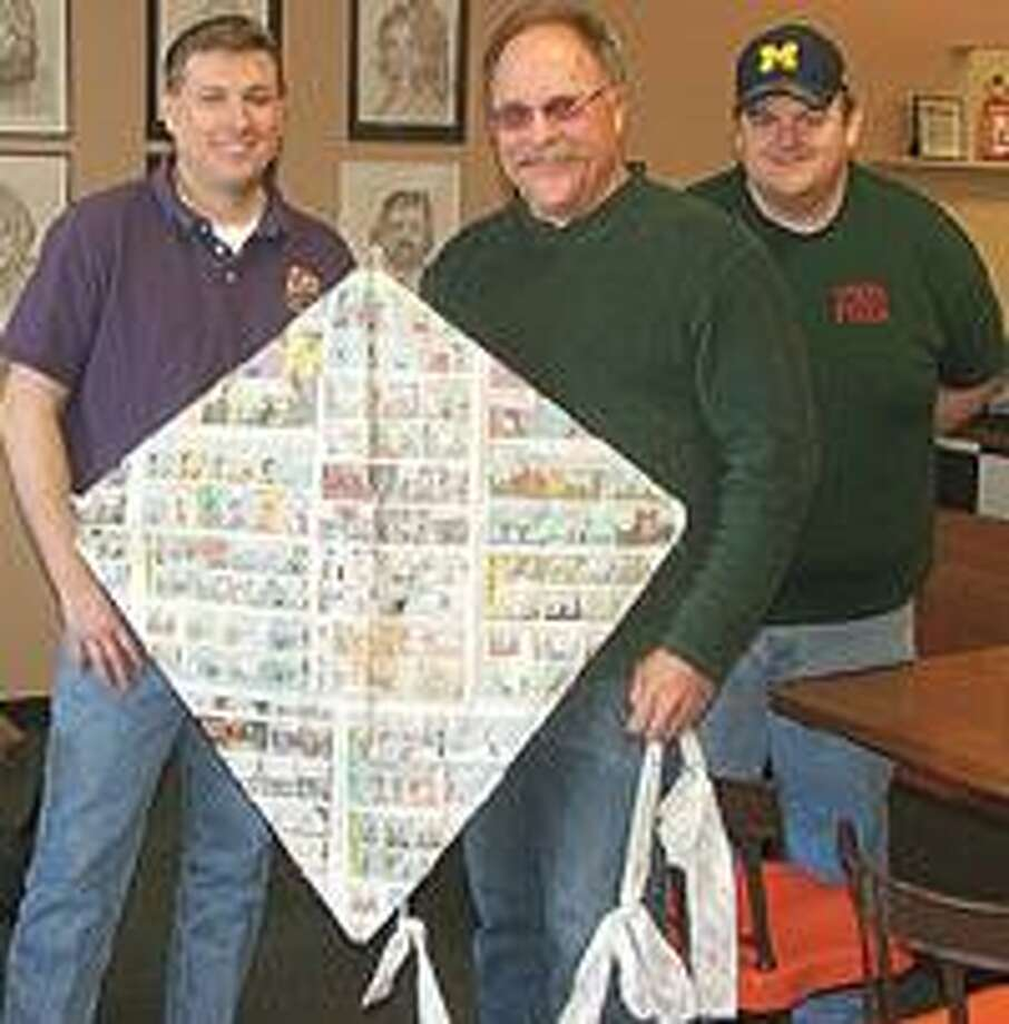 Organizer Jeff Taylor, center, is flanked by Toby Lawlor, left, of CC's Cyber Cafe, and Ken McCoy, right, of Treve's Pizza as they promote the upcoming Marlette Kite Fest slated for Saturday, May 8 at the field located near the Bea McDonald.
