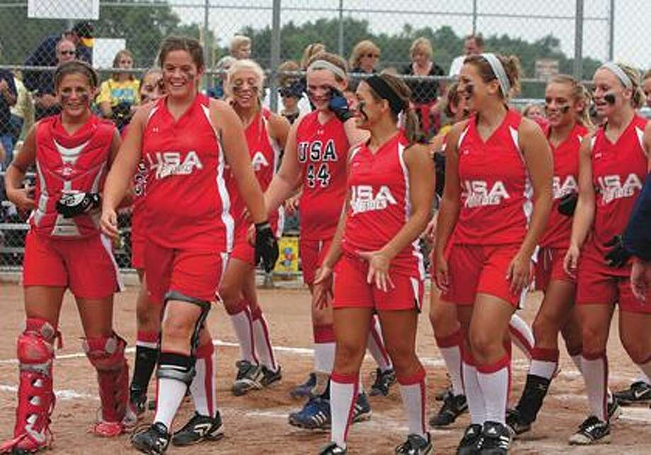 USA softball players celebrate after defeating North Muskegon, 5-2, in the Division 4 quarterfinals on Tuesday in Greenville.