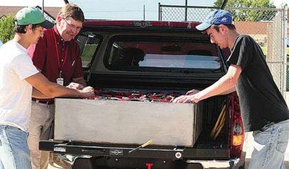 HATC students unveil gas to electric conversion vehicle.