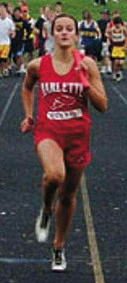 Angela Odoerfer competes as the anchor for the state-bound Marlette 400 meter relay team.