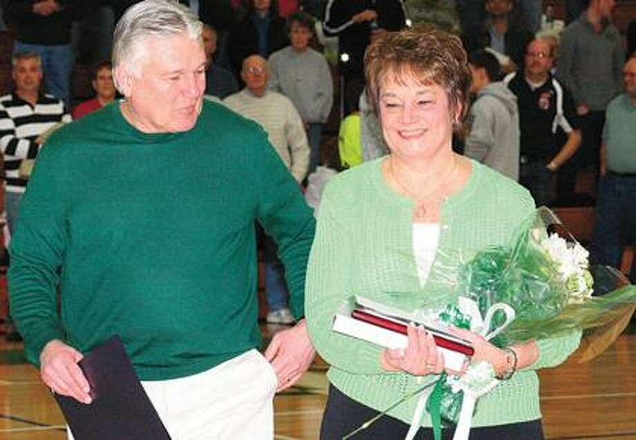 EPBP coach Bill McLellan and his wife, Dee, were honored in a pregame ceremony Thursday night. After 32 years and nearly 500 wins, McLellan is retiring as head basketball coach after this season.