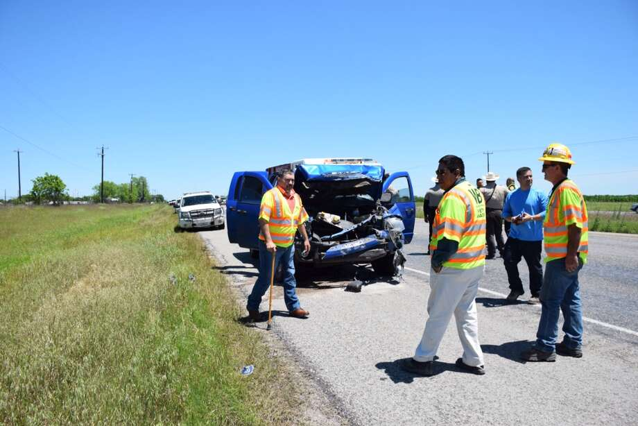 Law Enforcement officials investigate a crash involving five people, four of them children, in west Bexar County. Photo: By Mark D. Wilson/San Antonio Express-News