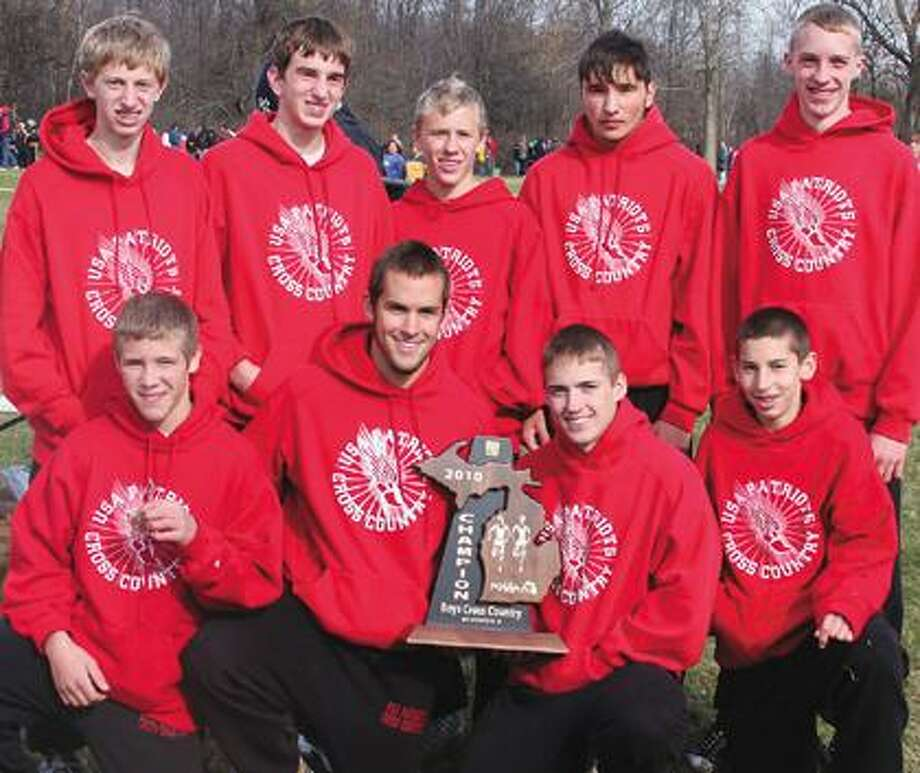 The USA cross country team poses with its trophy after winning the Division 4 regional on Saturday at Delta College.