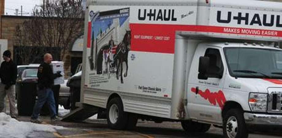 Investigators load a U-Haul truck at Seasons Change Home Health Care in Pigeon.