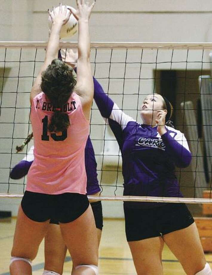 Bad Axe's Taylor Breault goes for a block during a pool play match with Caro.