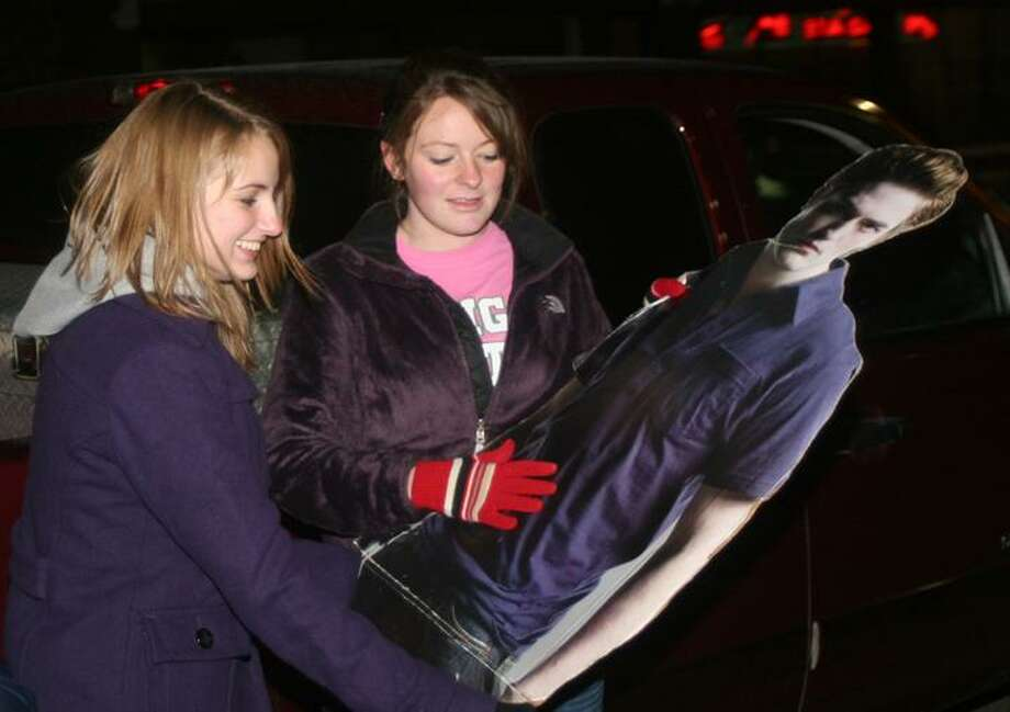 Alesha Reed, 17, and Sam Rochefort, 16, both of Bad Axe, hold a life-size cutout of Edward Cullen. View more photos on the Tribune's facebook page, http://www.facebook.com/group.php?gid=44400028758