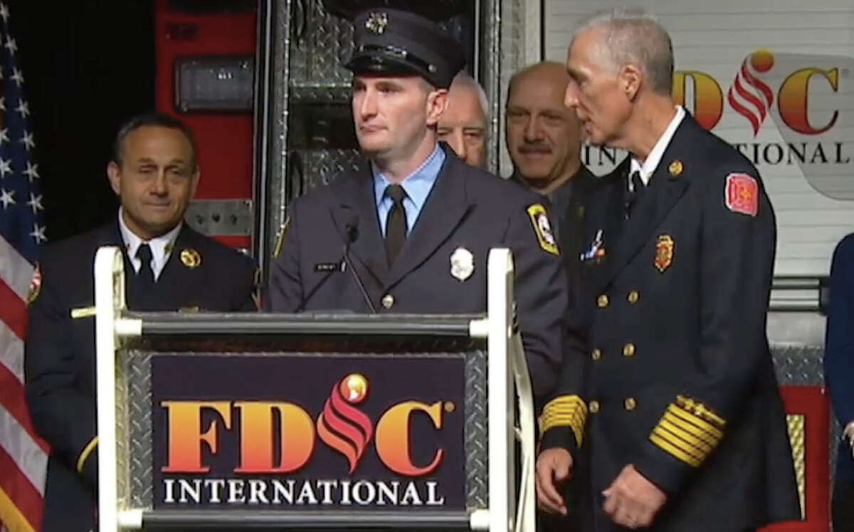 Firefighter Jason Rivera, of Newtown, receives the 2016 Ray Downey Courage and Valor Award at the Fire Department Instructors Conference in Indianapolis.