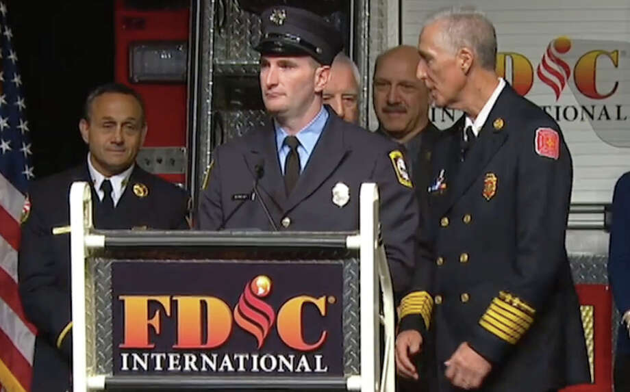 Firefighter Jason Rivera, of Newtown, receives the 2016 Ray Downey Courage and Valor Award at the Fire Department Instructors Conference in Indianapolis. Photo: Contributed Photo / Hearst Connecticut Media / The News-Times Contributed