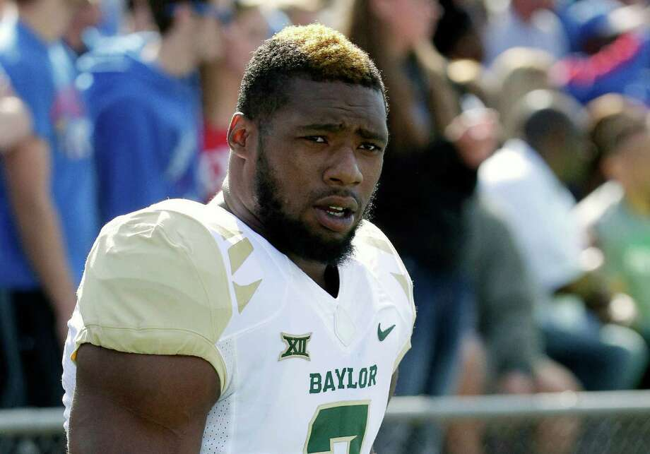 In this Oct. 10, 2015, file photo, then-Baylor defensive end Shawn Oakman warms up before an NCAA college football game against Kansas in Lawrence, Kan. NFL prospect and former Baylor football player Oakman was arrested Wednesday, April 13, 2016, on a charge of sexually assaulting a woman at his Texas apartment earlier this month, Waco police said. Photo: Charlie Riedel /AP / AP