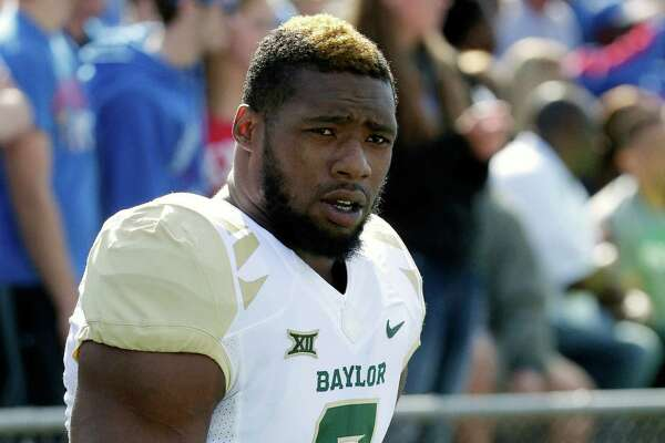 In this Oct. 10, 2015, file photo, then-Baylor defensive end Shawn Oakman warms up before an NCAA college football game against Kansas in Lawrence, Kan. NFL prospect and former Baylor football player Oakman was arrested Wednesday, April 13, 2016, on a charge of sexually assaulting a woman at his Texas apartment earlier this month, Waco police said.
