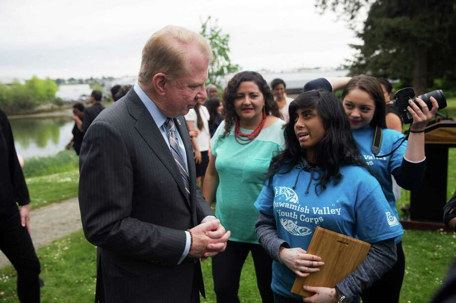 Seattle Mayor Ed Murray has used immigrant rights as a grounding for city social and environmental policy.  Here, he meets with the Duwamish Valley Youth Corps.  After Thursday's Supreme Court ruling, Murray put it bluntly:  City services will be offered to everyone.  Nobody will be asked their immigration status.  Nor will the city inform on anybody to the feds. Photo: GRANT HINDSLEY, SEATTLEPI.COM / SEATTLEPI.COM