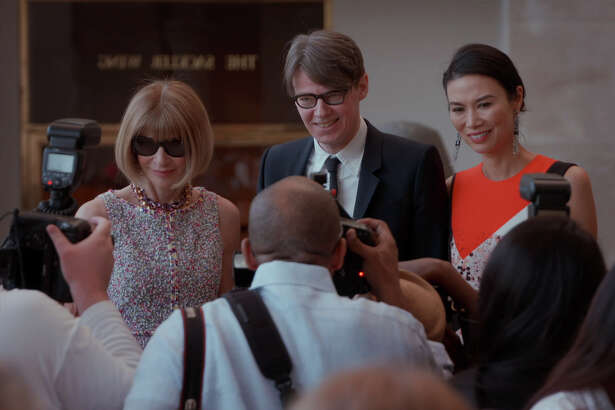 "Vogue editor Anna Wintour, Metropolitan Museum curator Andrew Bolton and socialite Wendi Murdoch greet the press in ""First Monday in May,"" the new documentary about the annual gala for the Met's Costume Institute."