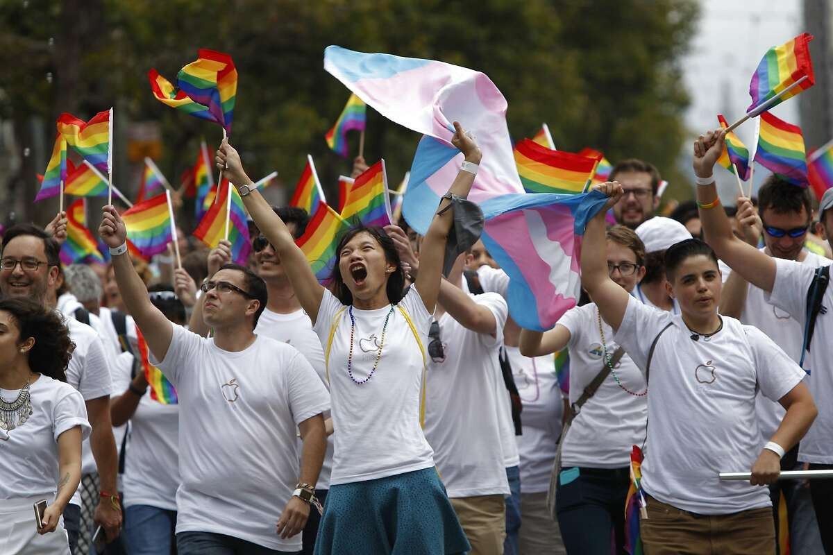 Pride supporters of Apple yell and cheer as they make their way down Mark Street during the Pride Parade in San Francisco, California, on Sunday, June 28, 2015.
