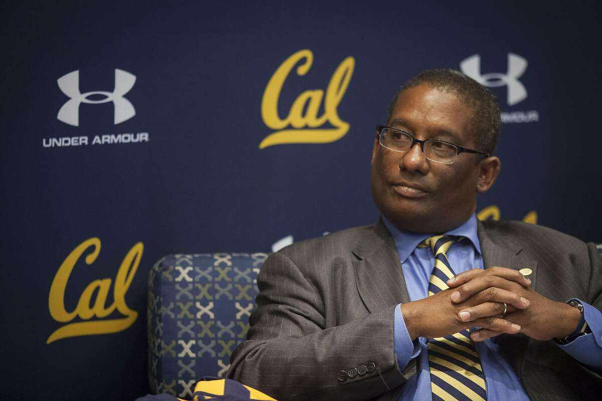 University of Berkeley Athletics Director Mike Williams look so at Under Armour CEO Kevin Plank during their announcement of the new 10 year apparel agreement starting on July 01, 2017 to outfit athletes campus wide in UC Berkeley, California, USA 22 Apr 2016. (Peter DaSilva/Special to The Chronicle)